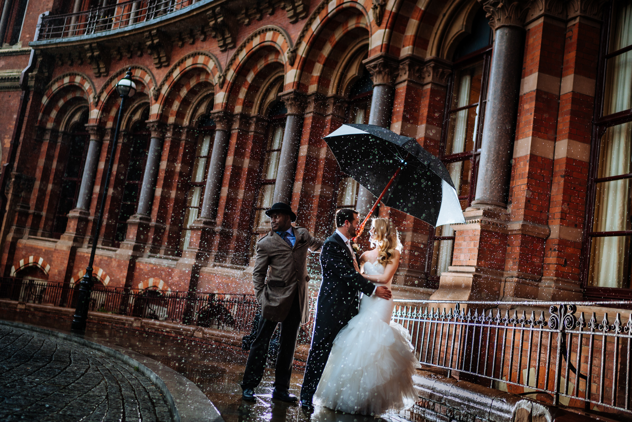 bride and groom in the london rain
