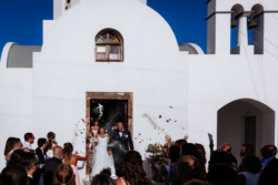 Bride and groom walk out of the church