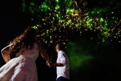 Brideand groom dance with green lighting