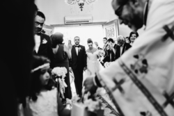 Black and white image with bride, groom, and guests