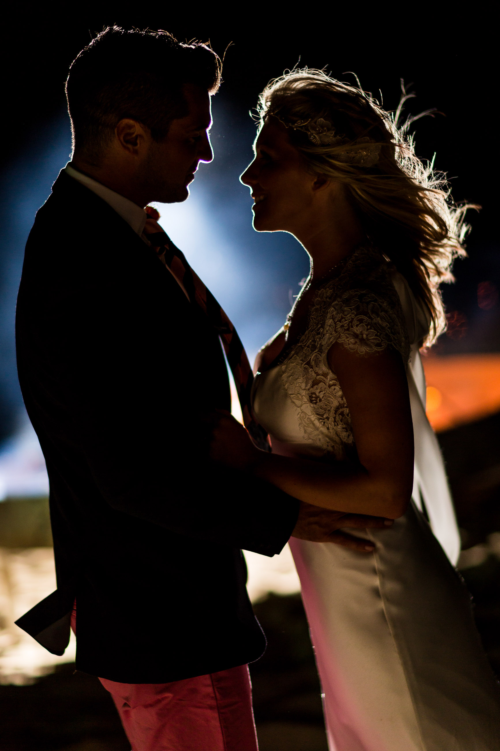 Close up of bride and groom at night