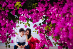 Couple with lots of pink flowers