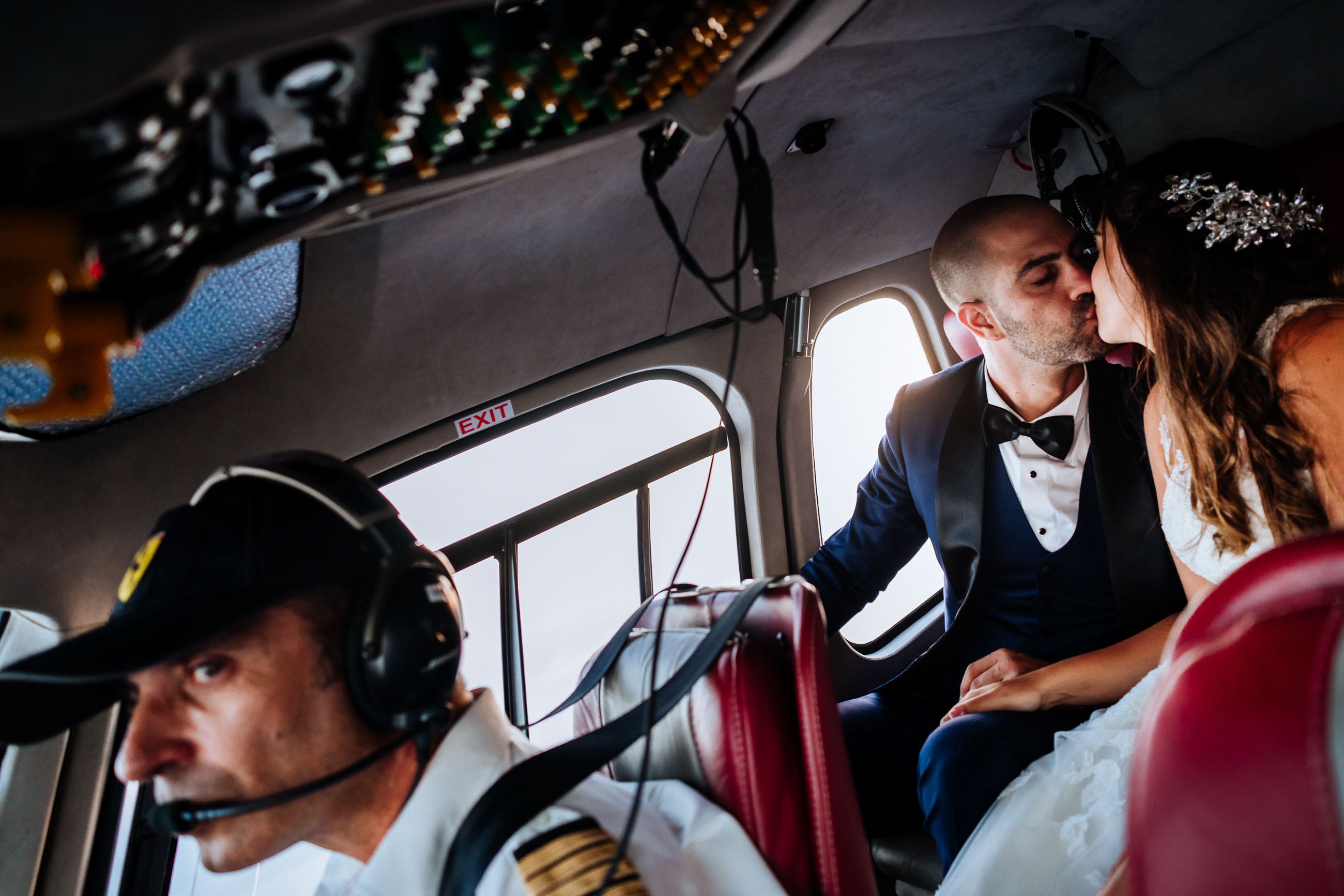 Couple kissing in helicopter