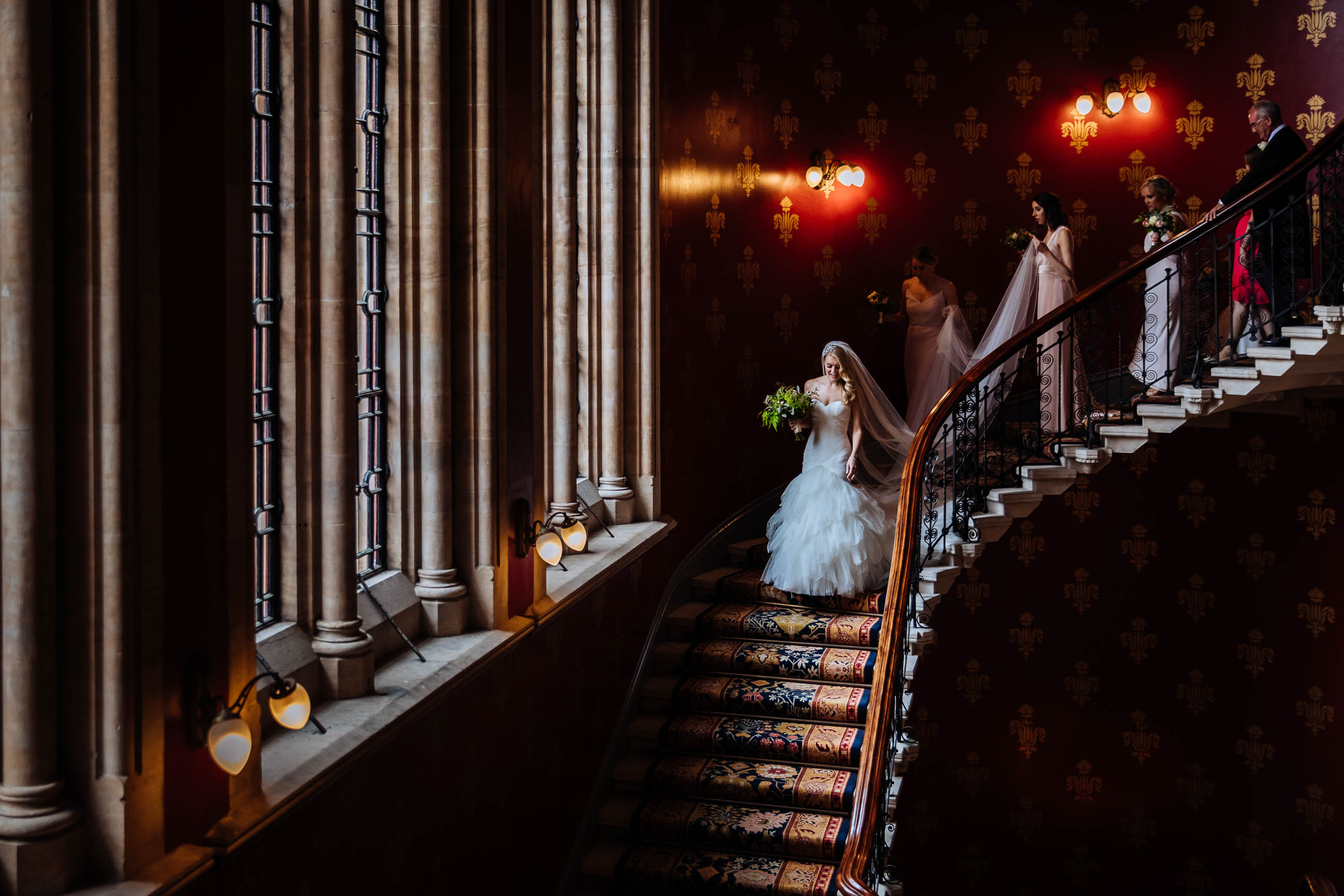 bride walking down stairs at London wedding photography