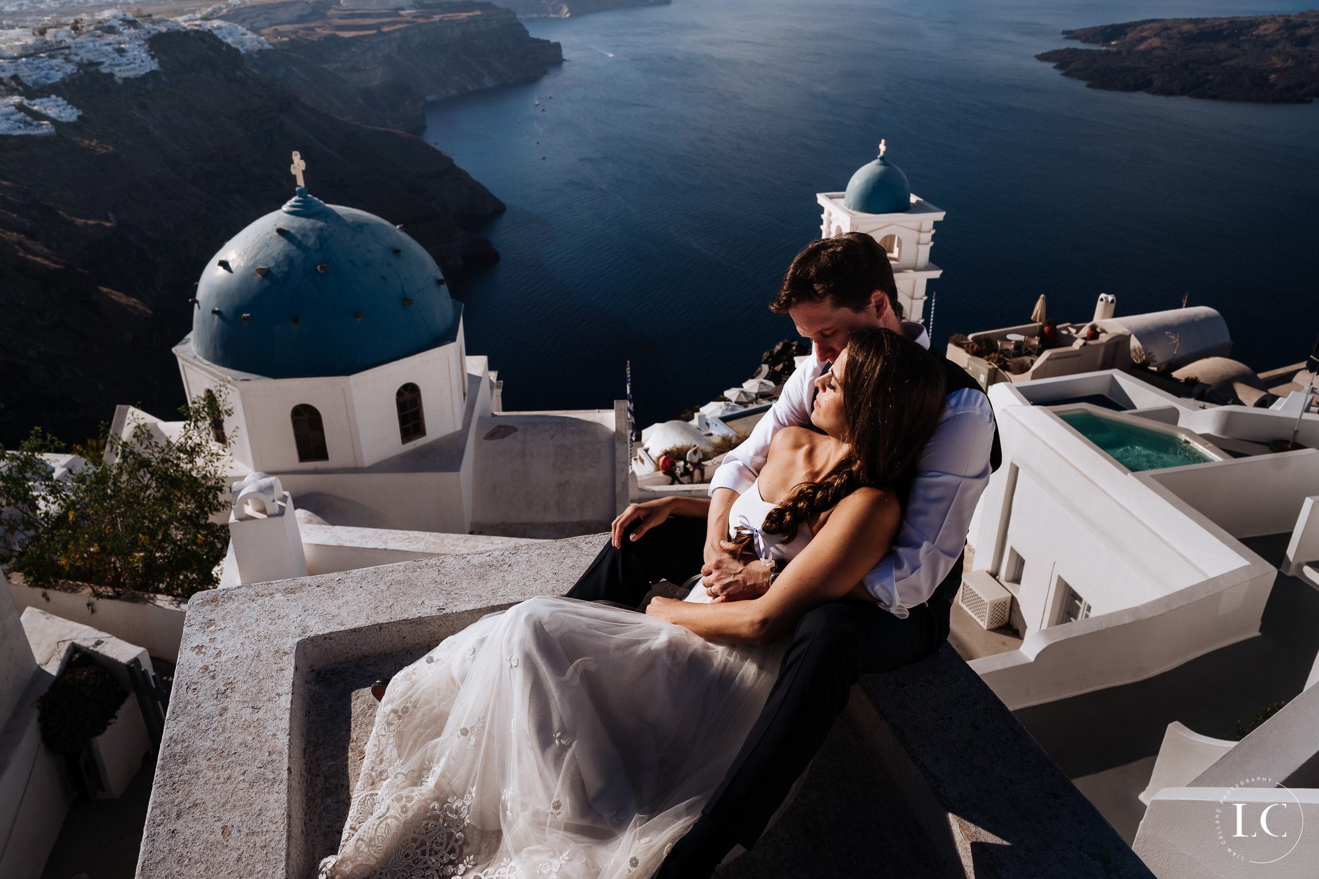 Couple embracing with Santorini view