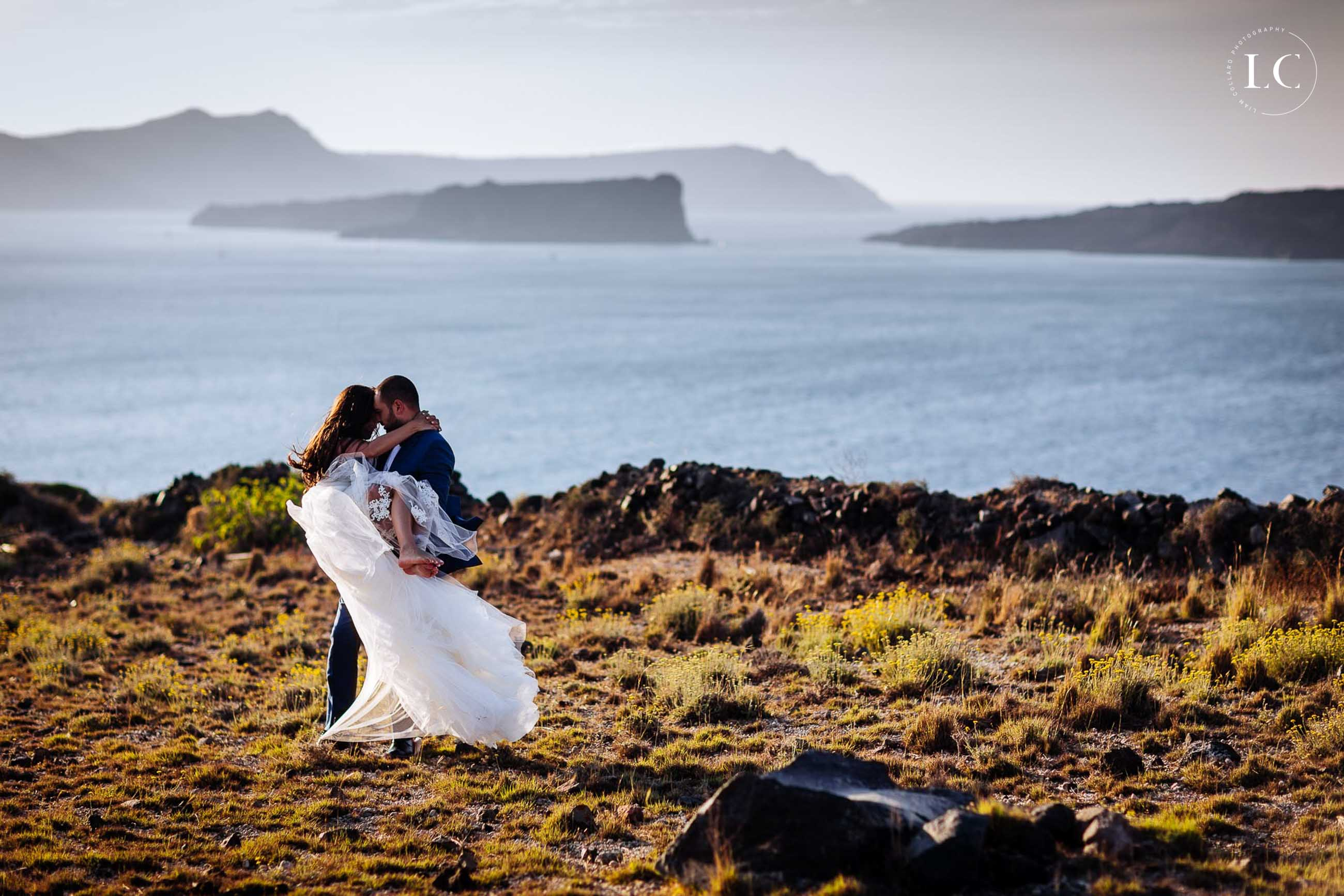 Bride and groom beside a lake