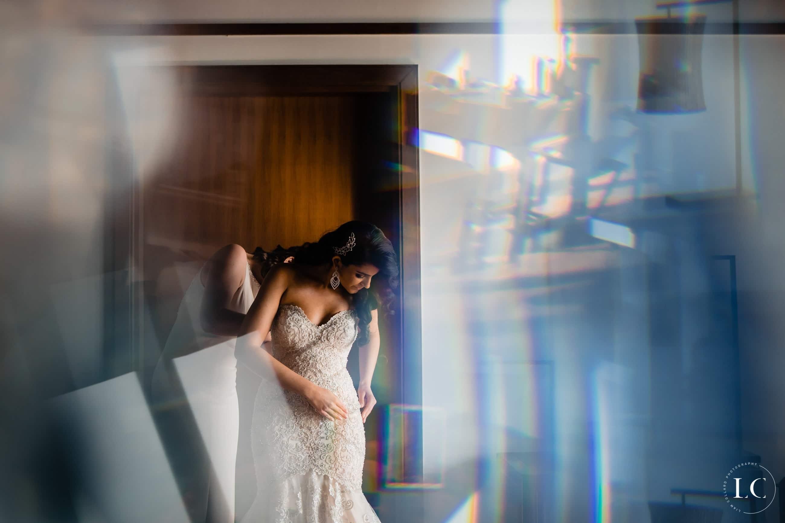 Distorted image of bride fixing her dress