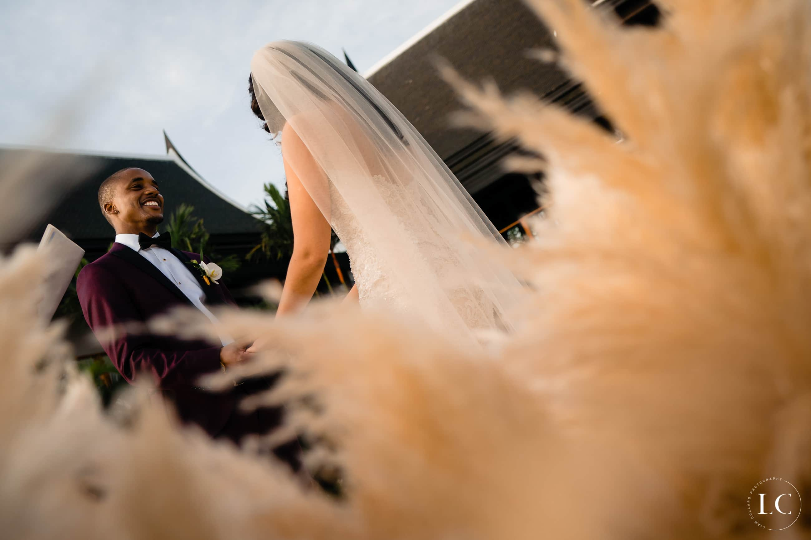 Distorted low angle shot of bride from behind