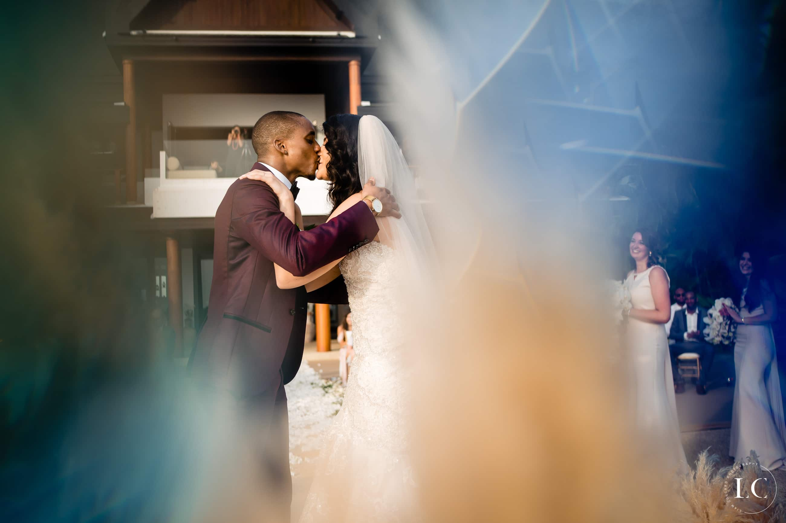 Distorted view of bride and groom kissing