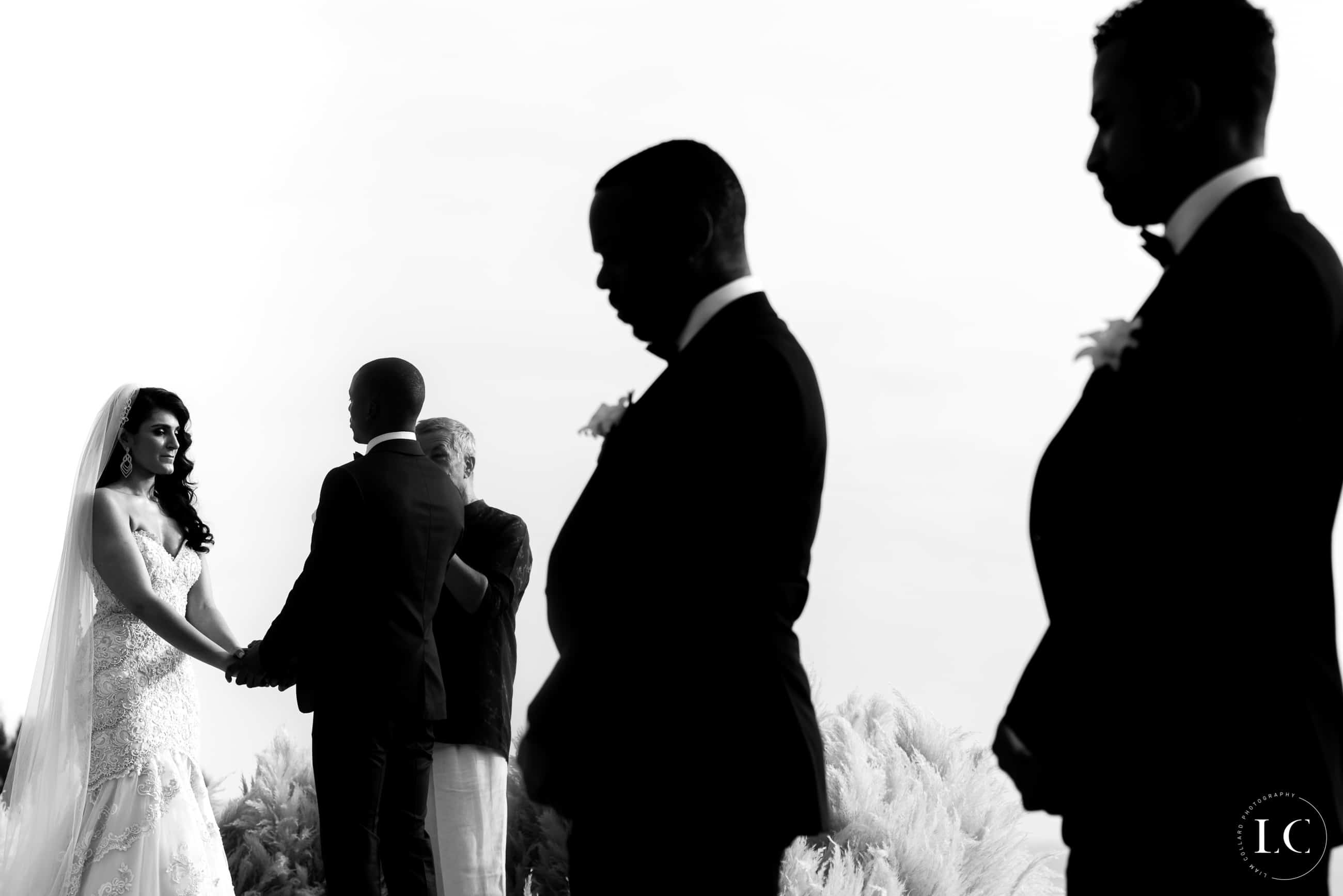 Black and white of groommen and best man