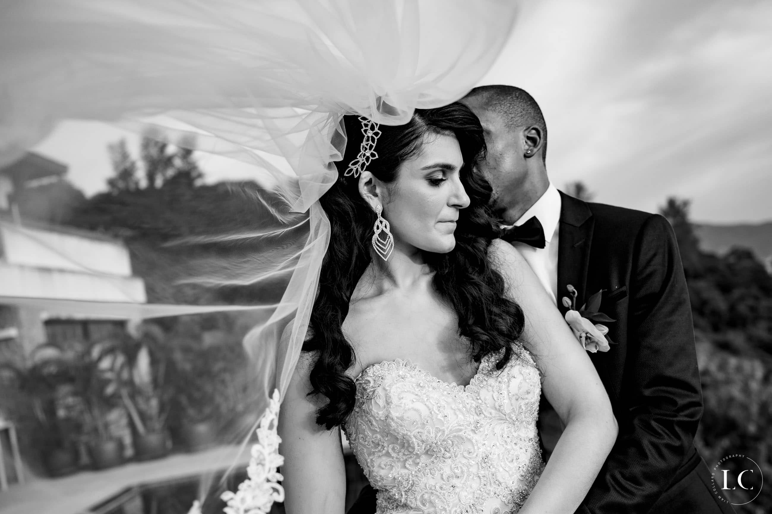 Intimate black and white newly weds