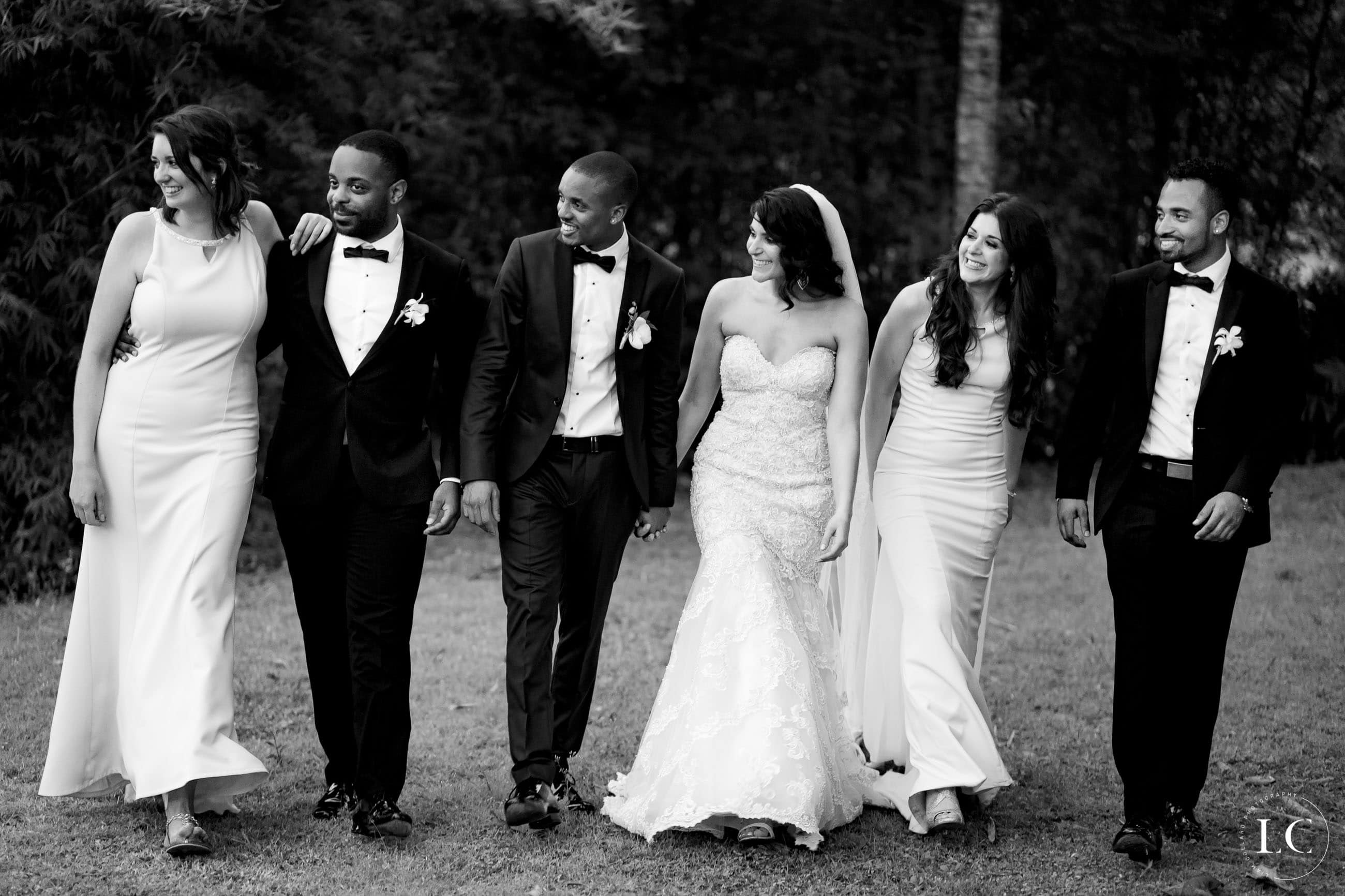 Black and white photo of newly weds and wedding party