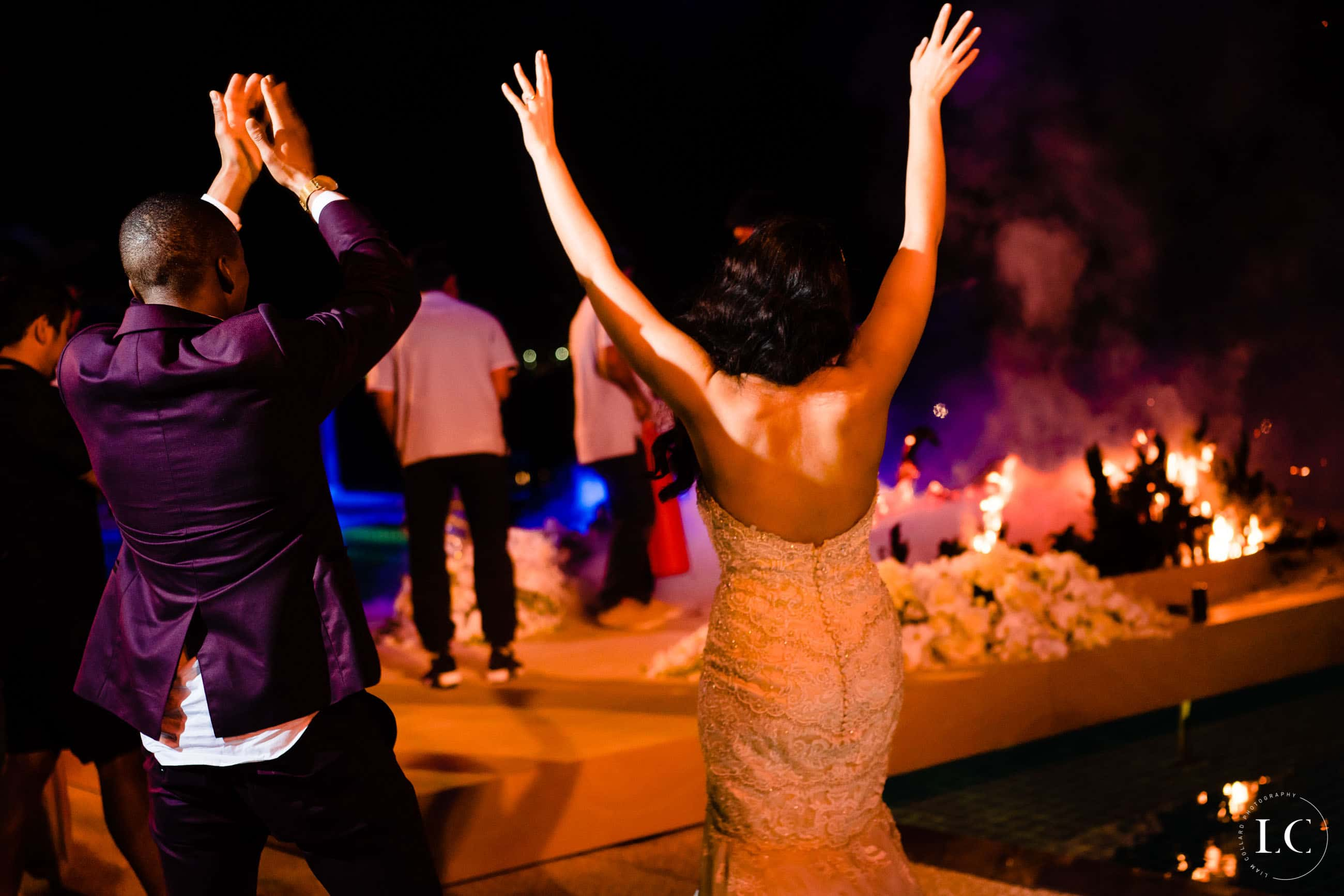 Dancing at reception, bride with arms up