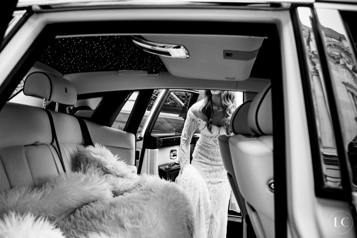 Bride getting in car