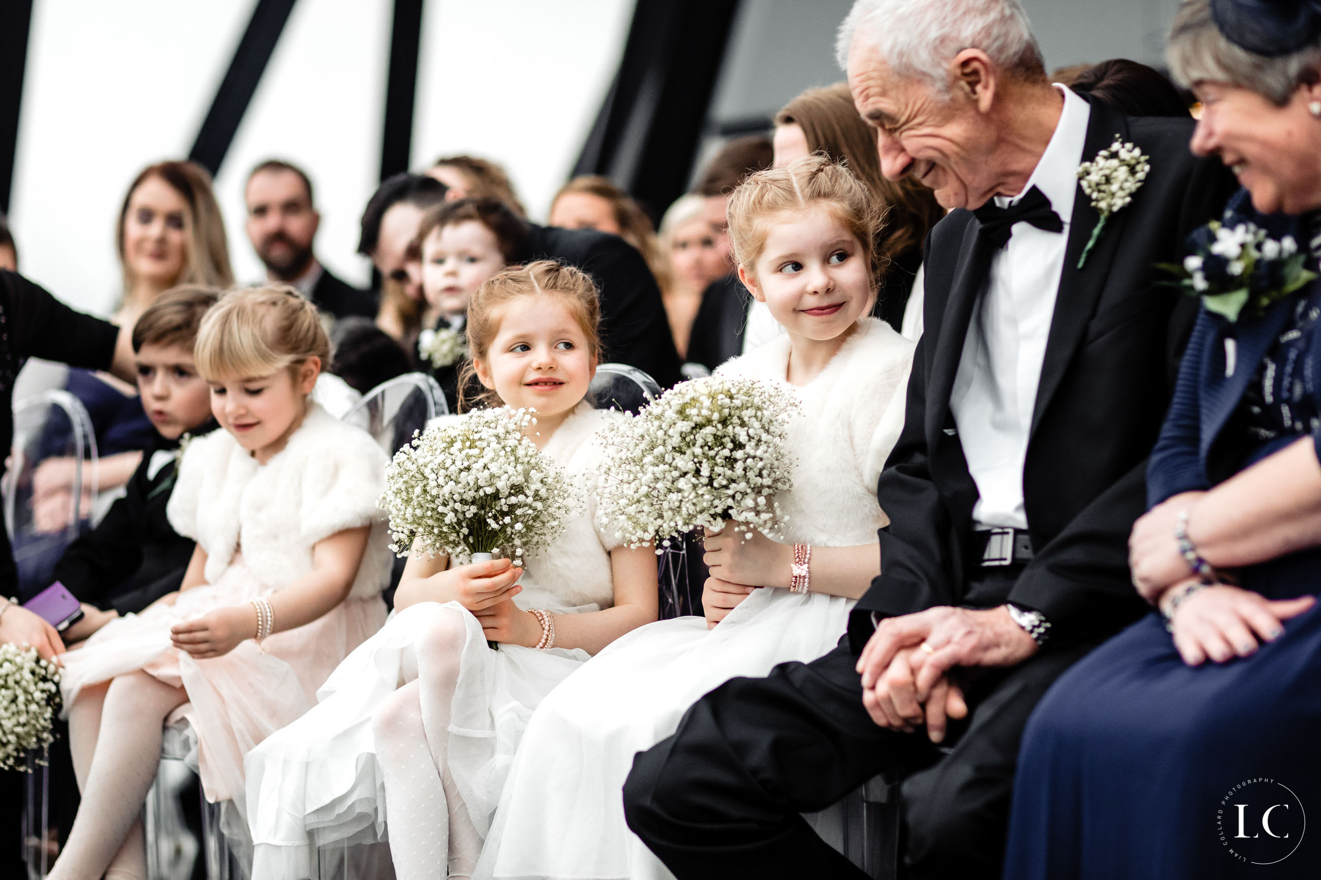 Children and guests seated