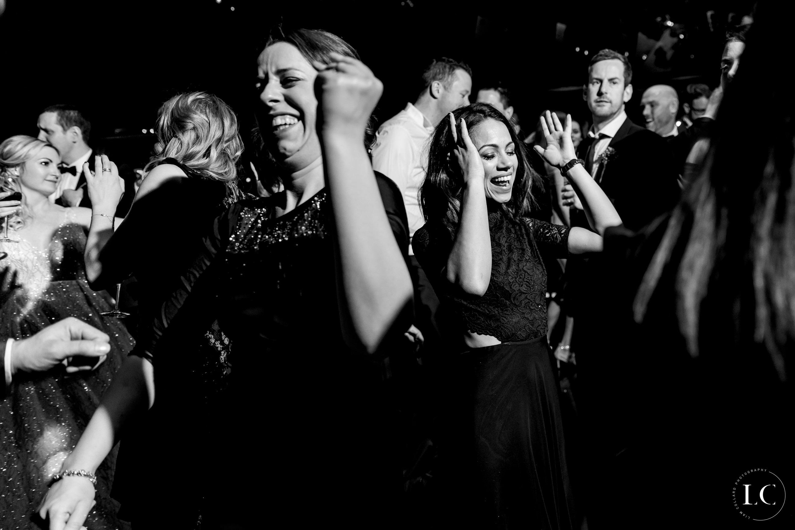 Happy guests dancing