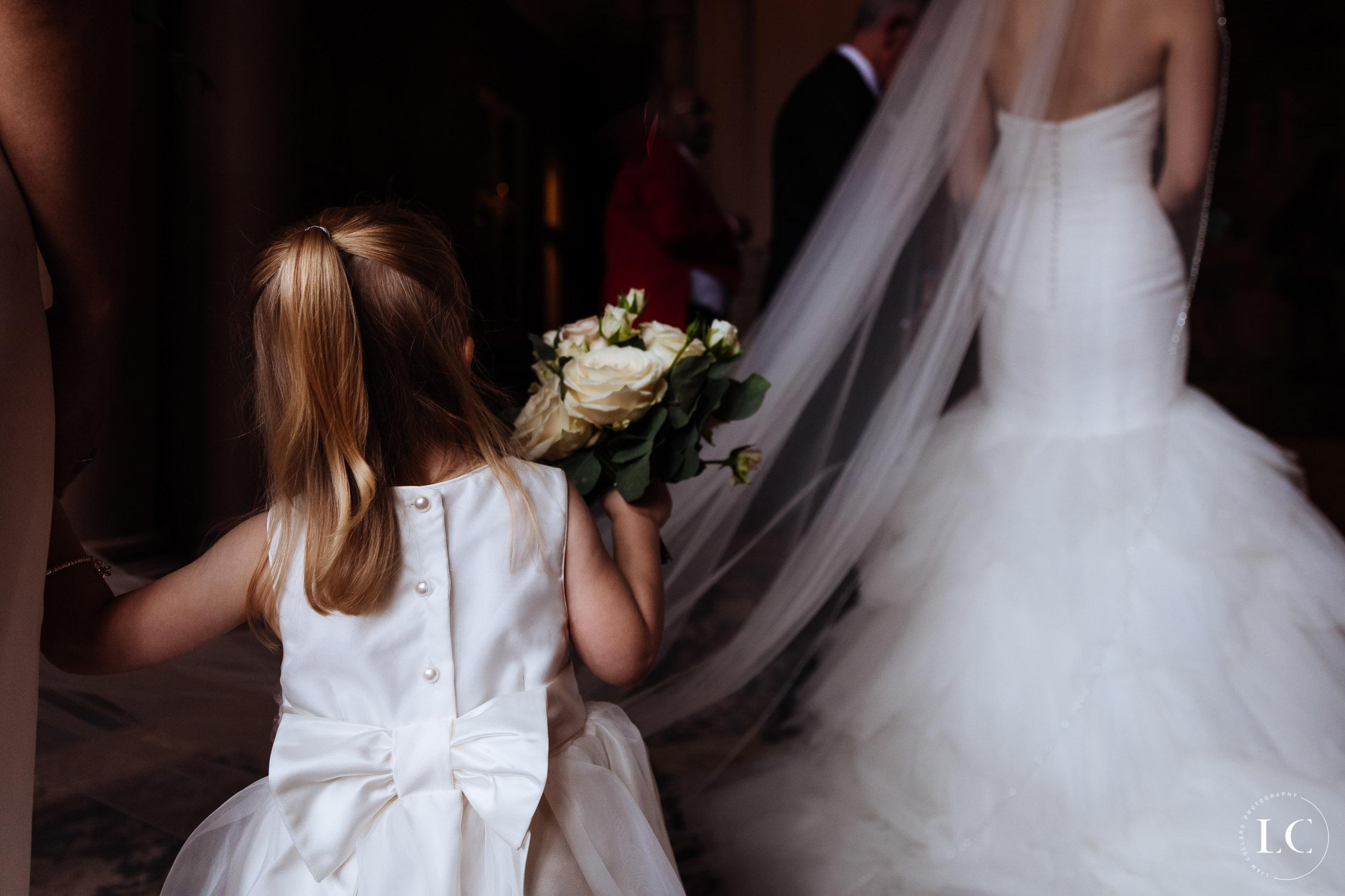 A child touching the wedding dress