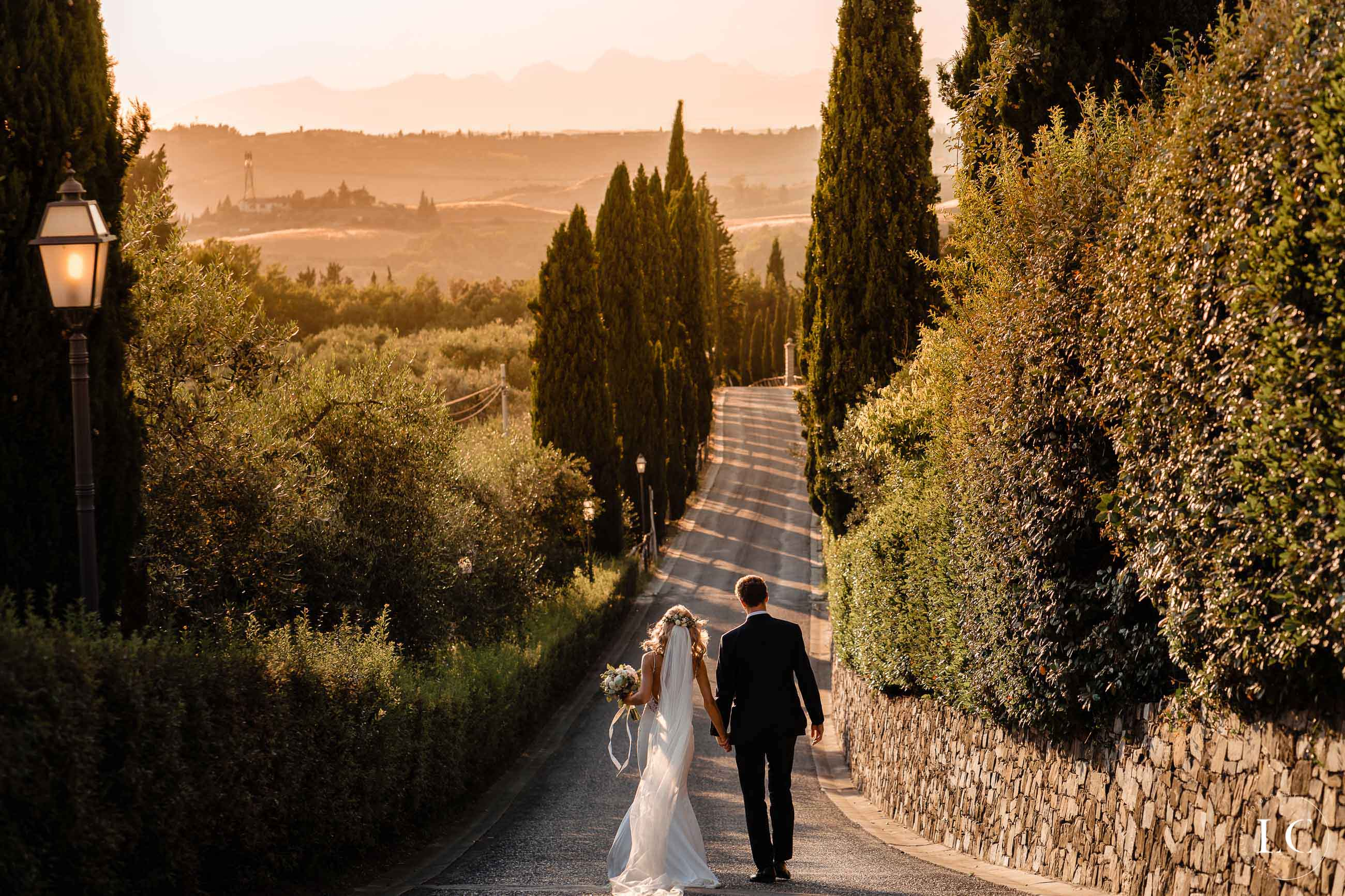 Newly weds walking at sunset