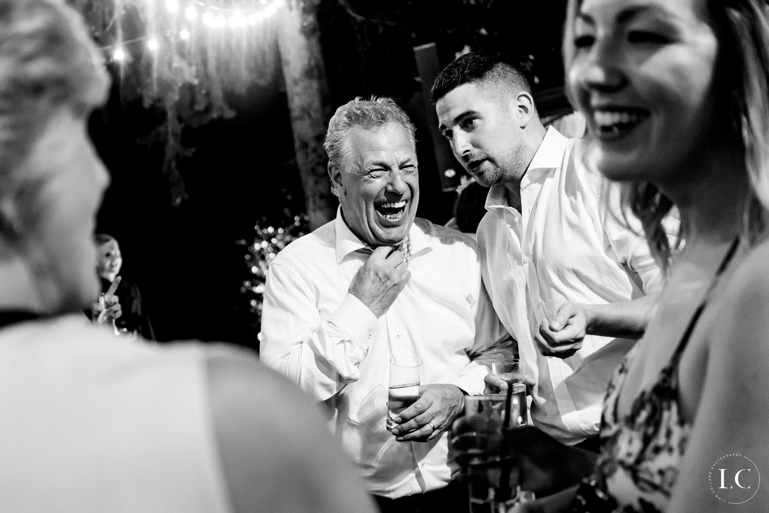 Men talking and laughing