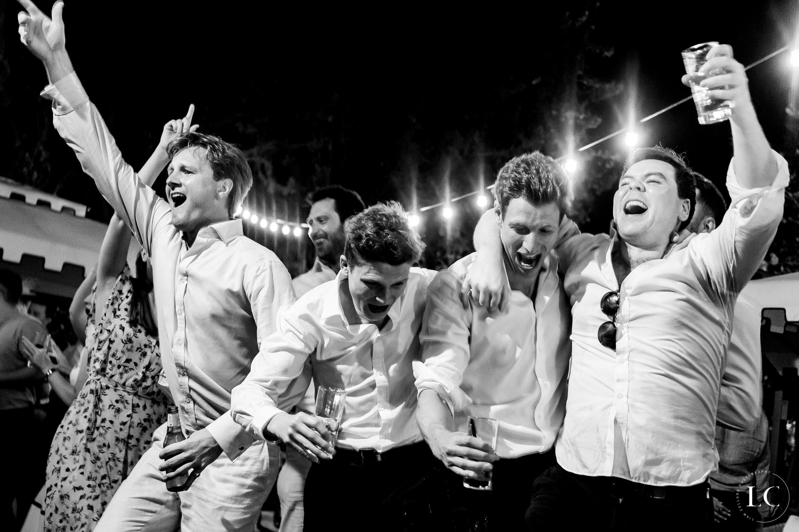 Groomsmen dancing and laughing