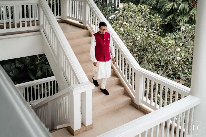 Indian groom walking down stairs