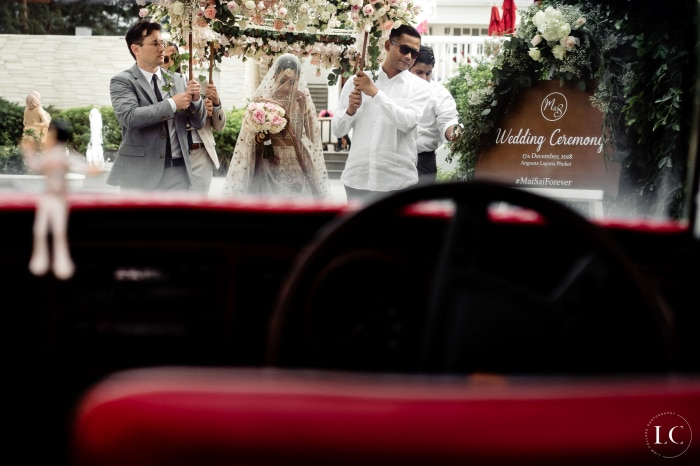 View of wedding guests from a car