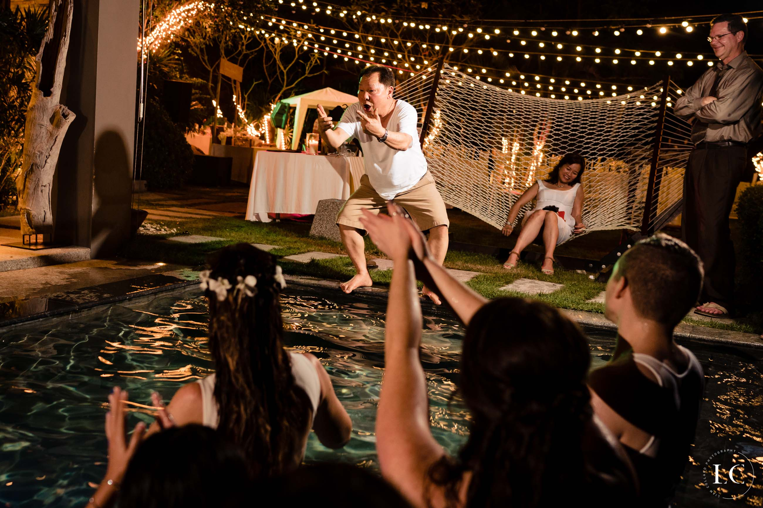 wedding guest jumping into pool