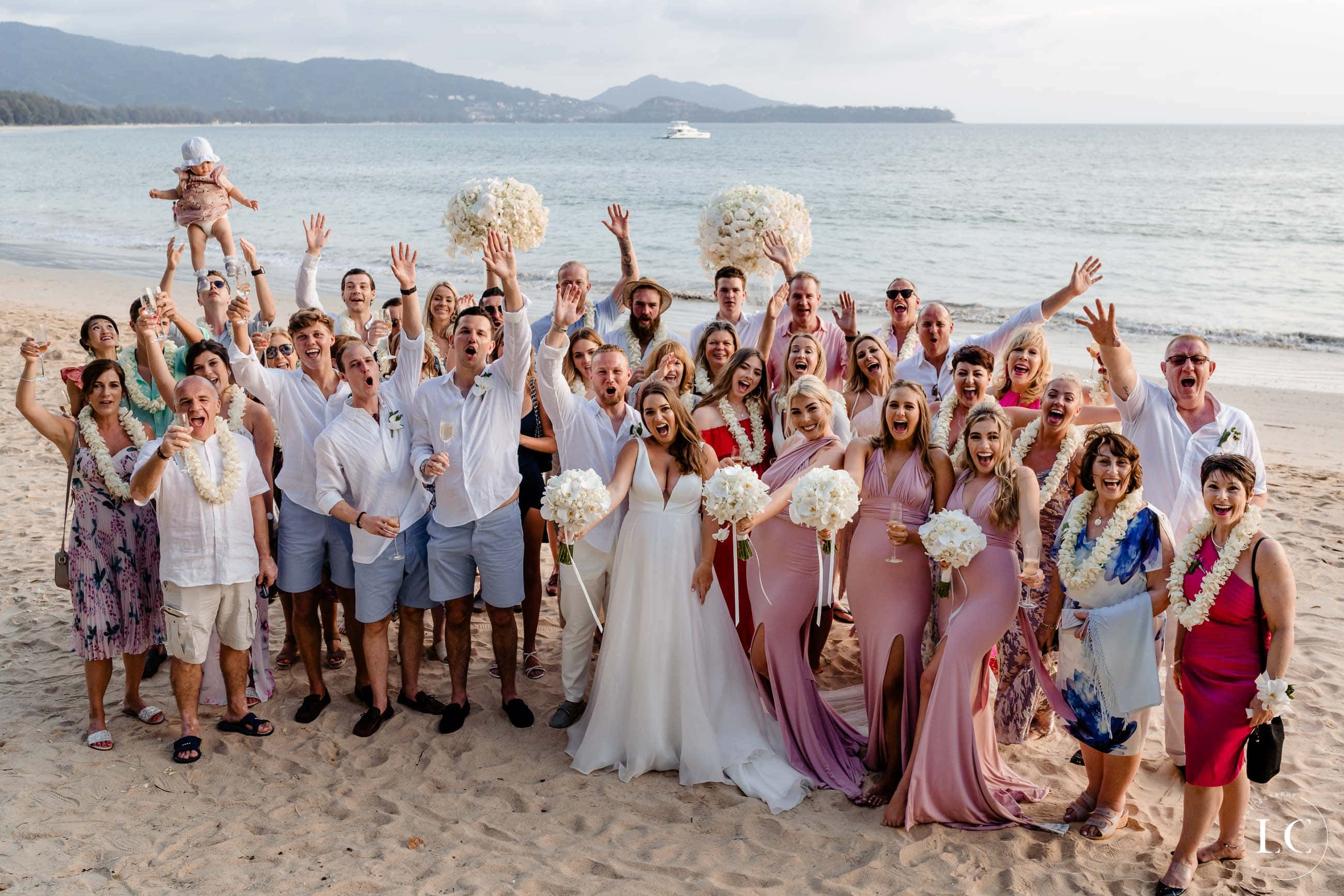 wedding party group photo on beach