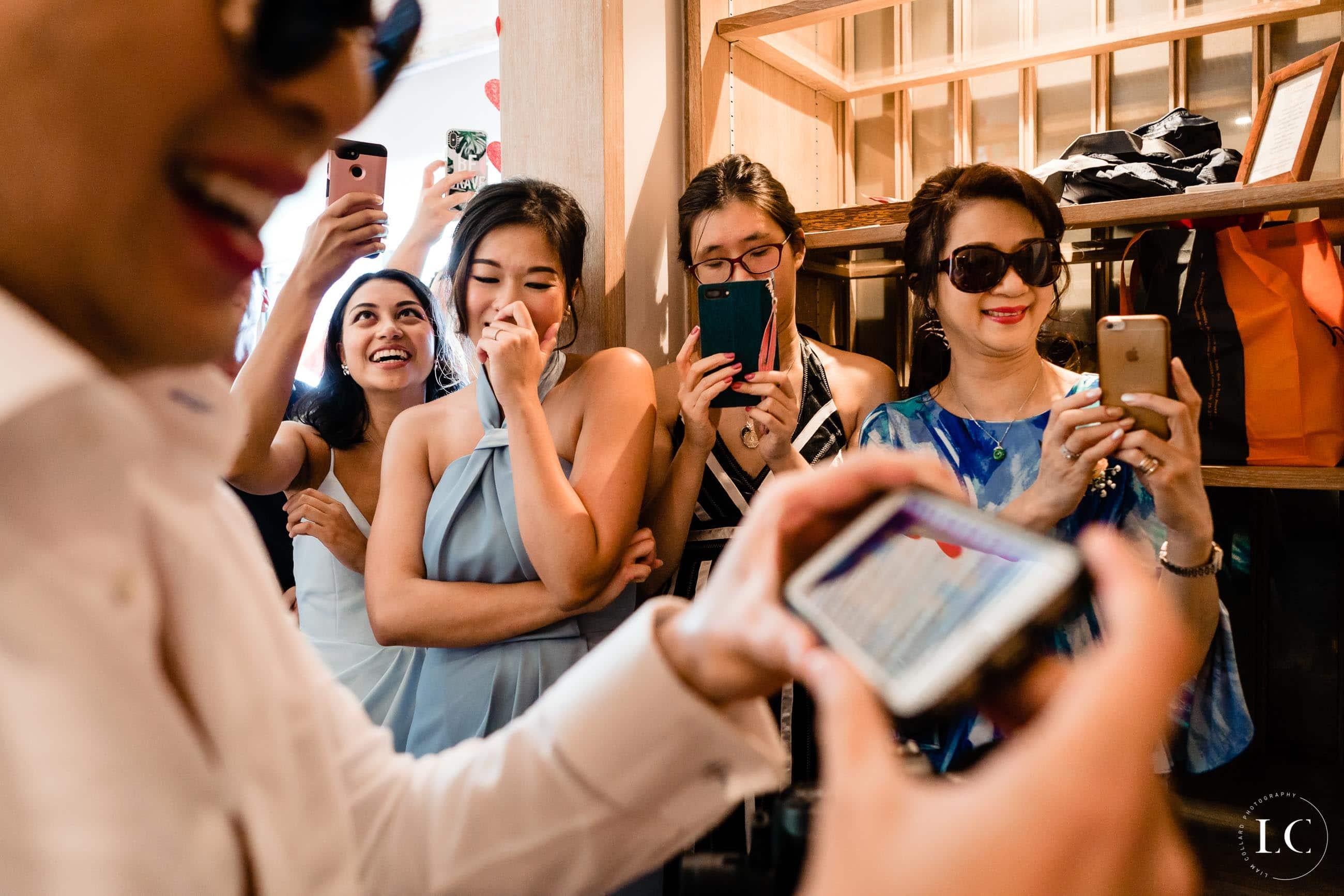 Guests taking photos at a wedding
