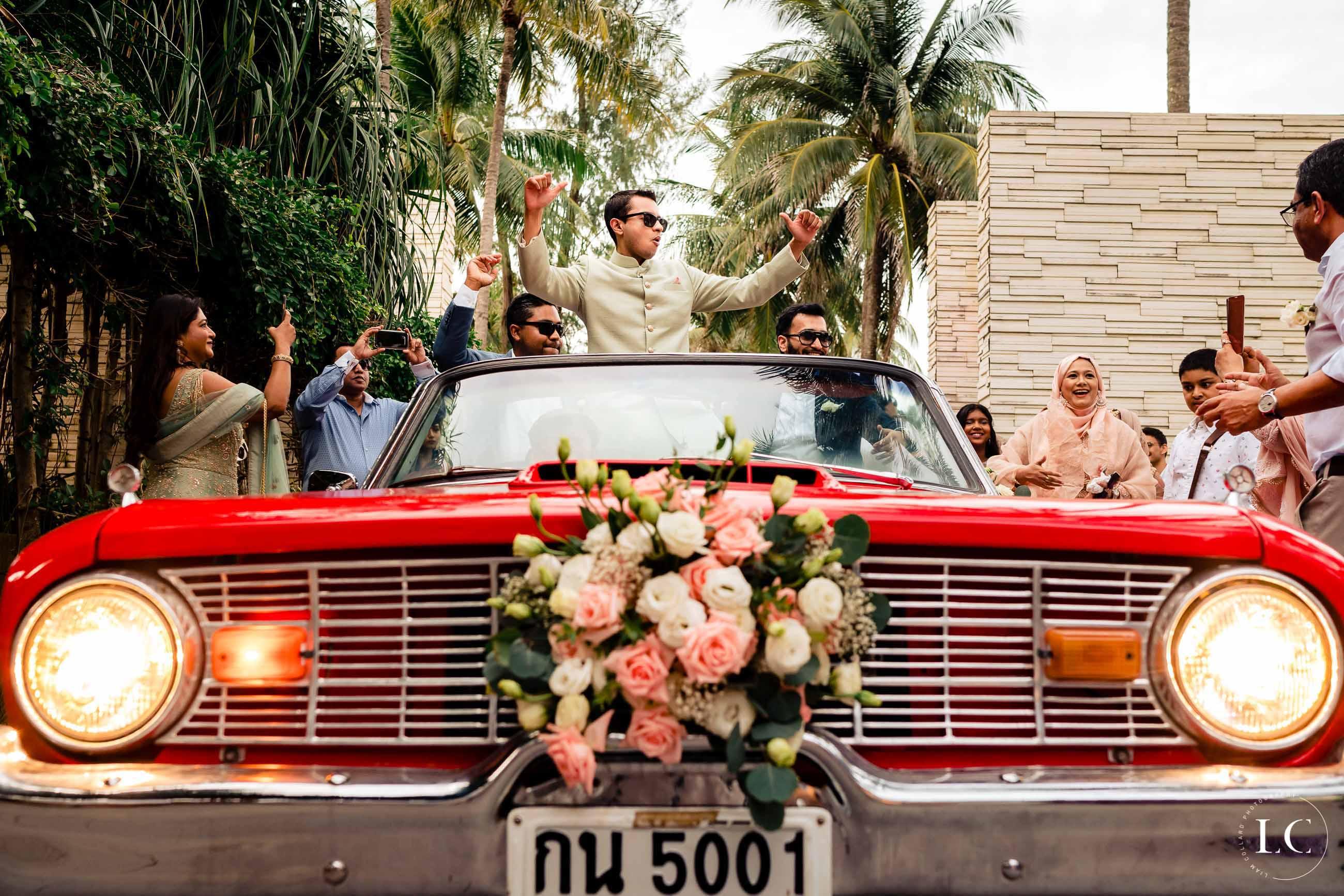 Indian wedding groomsmen in a car