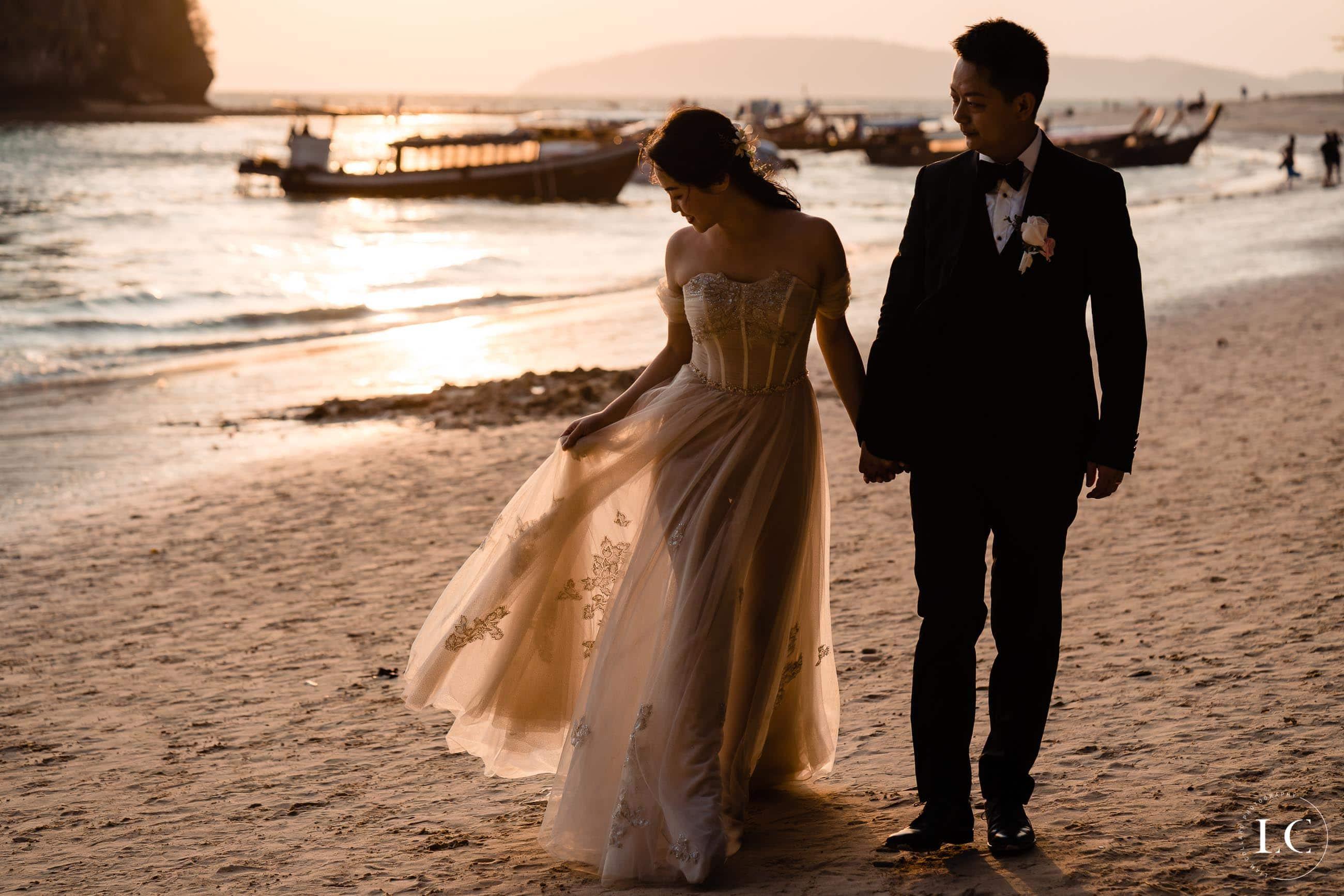 Bride and groom on beach sunset