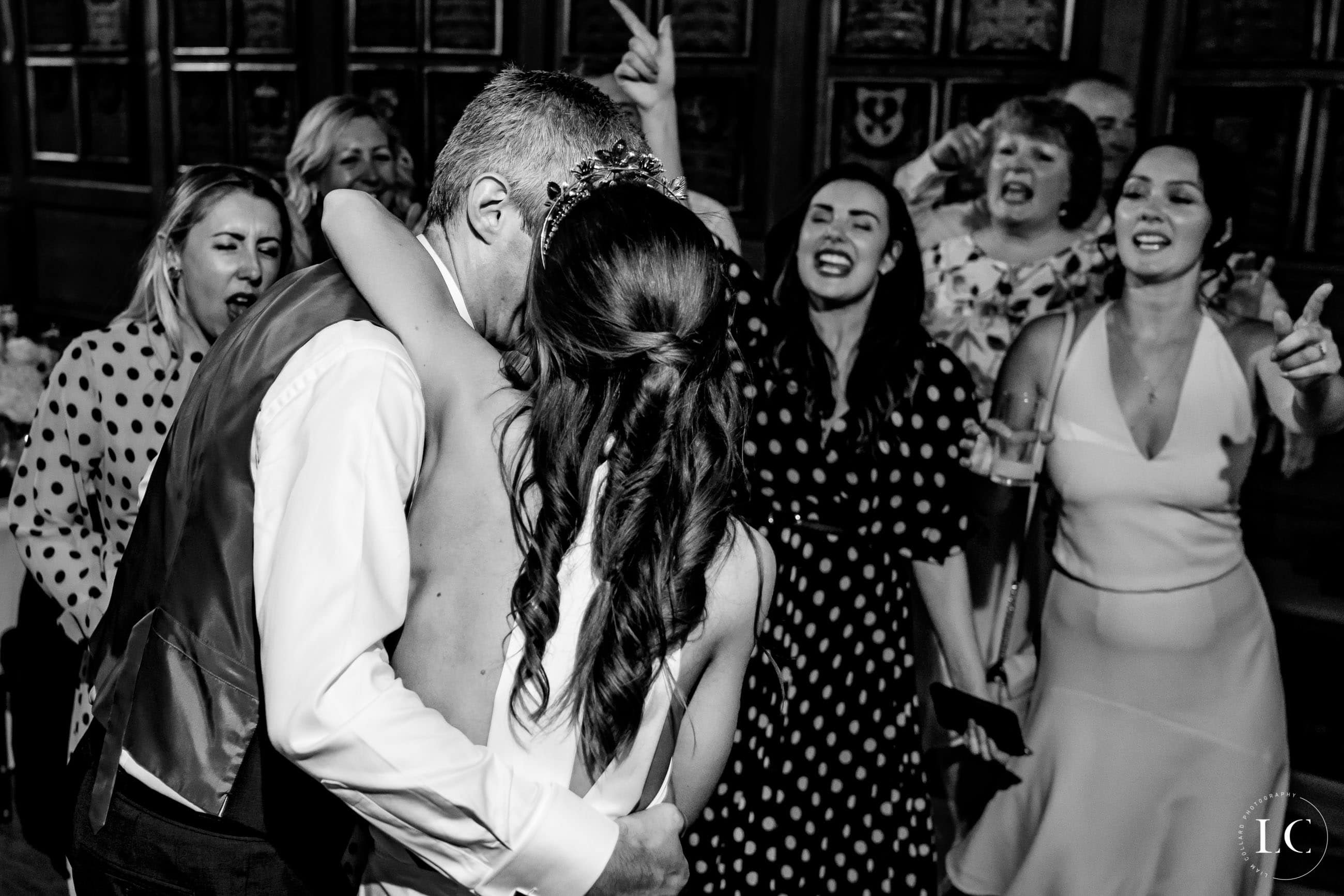 People embracing at wedding party