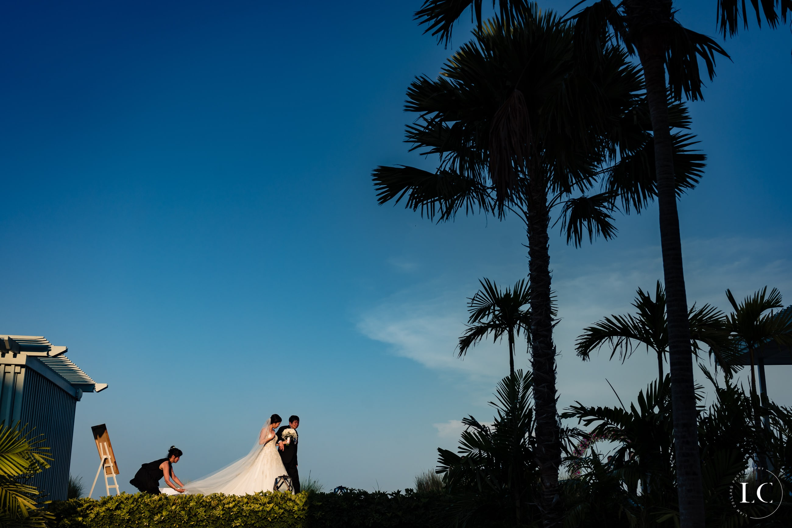 Bride and groom outside at sunset
