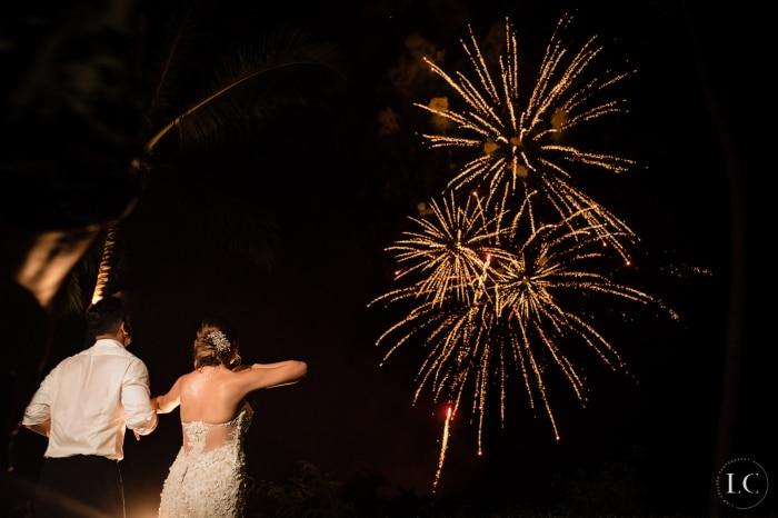 Bride and groom look at fireworks