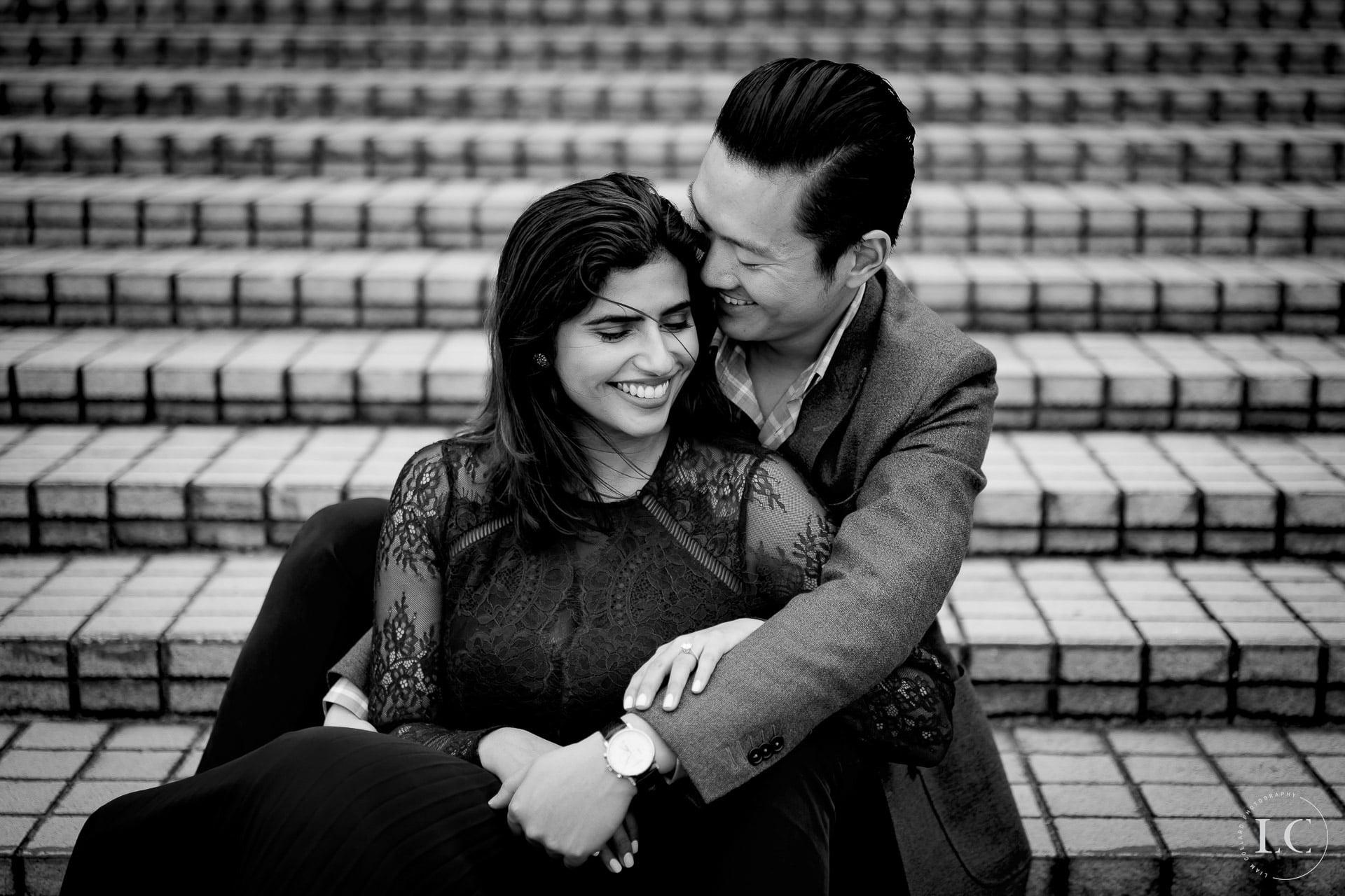 Bride and groom hugging sitting on steps