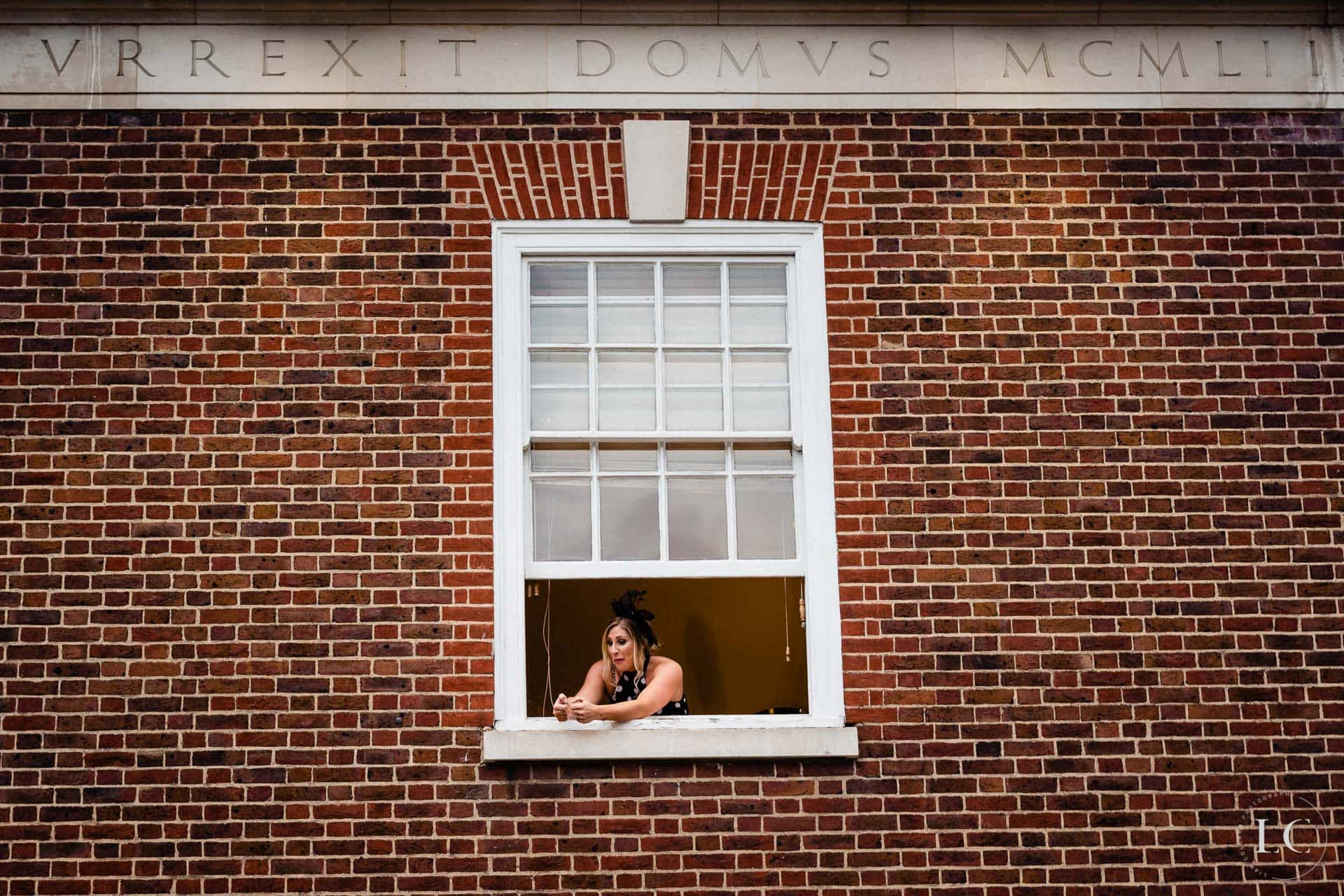 Bride leaning out of window