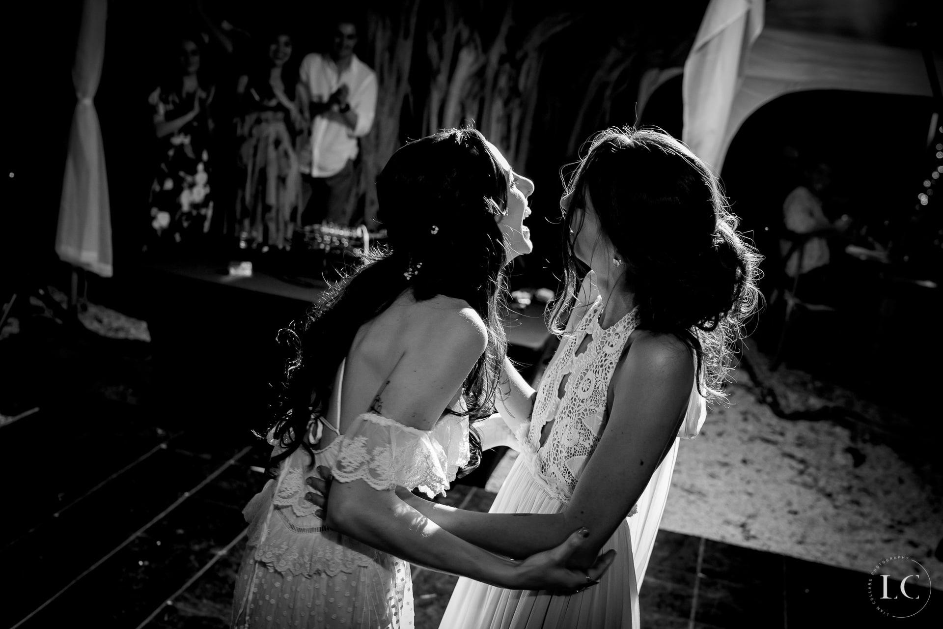 Same sex brides laughing