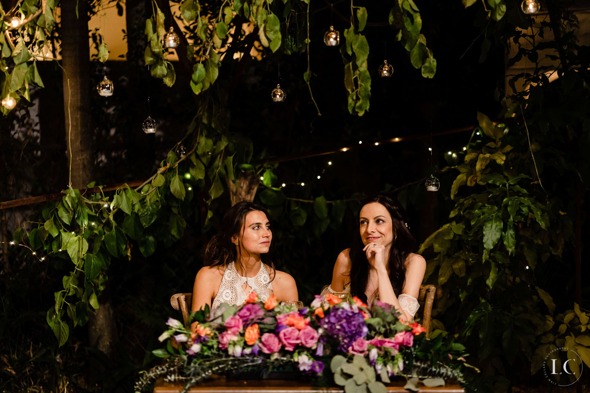 Same sex brides seated