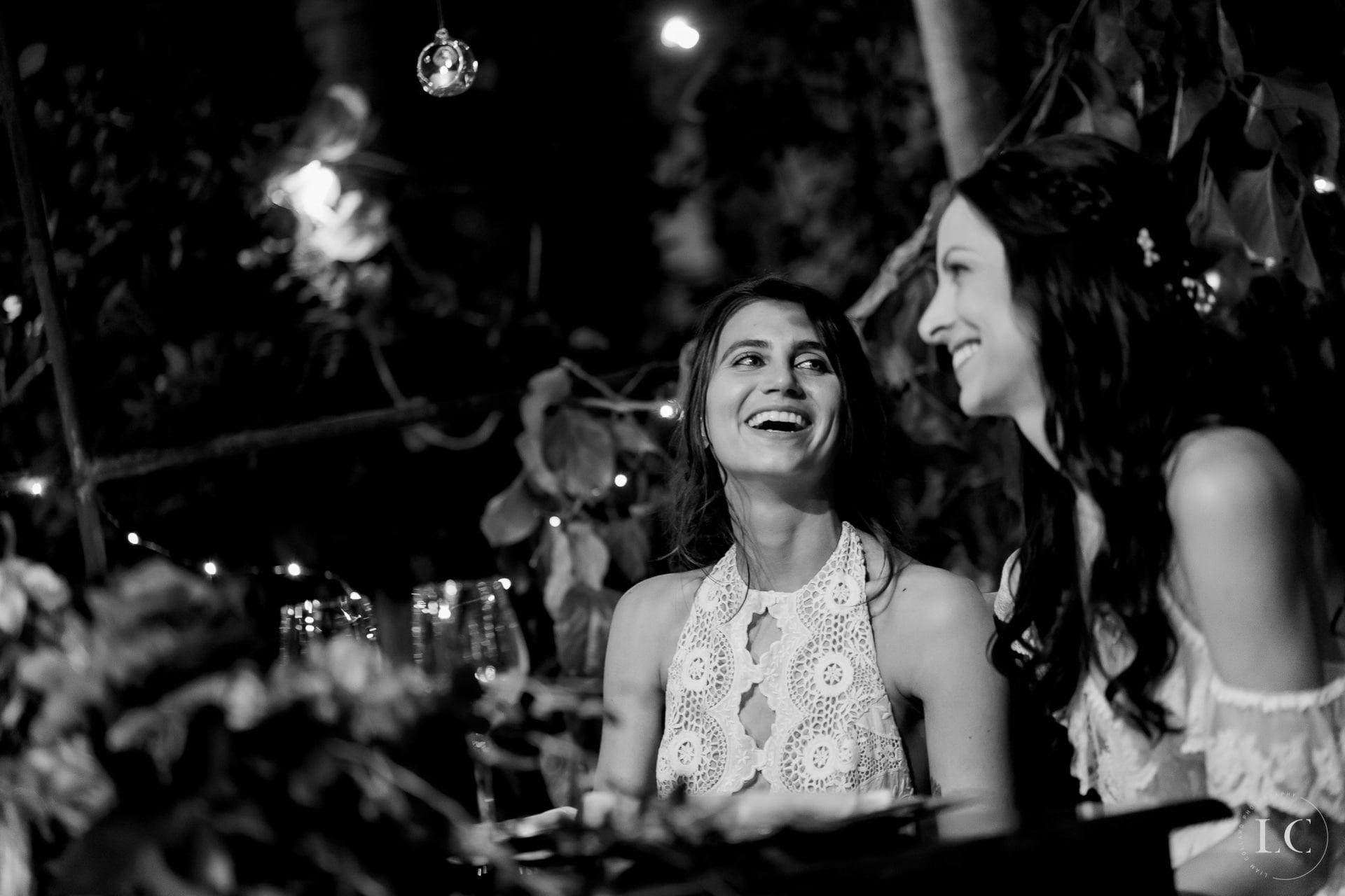 Same sex brides smiling
