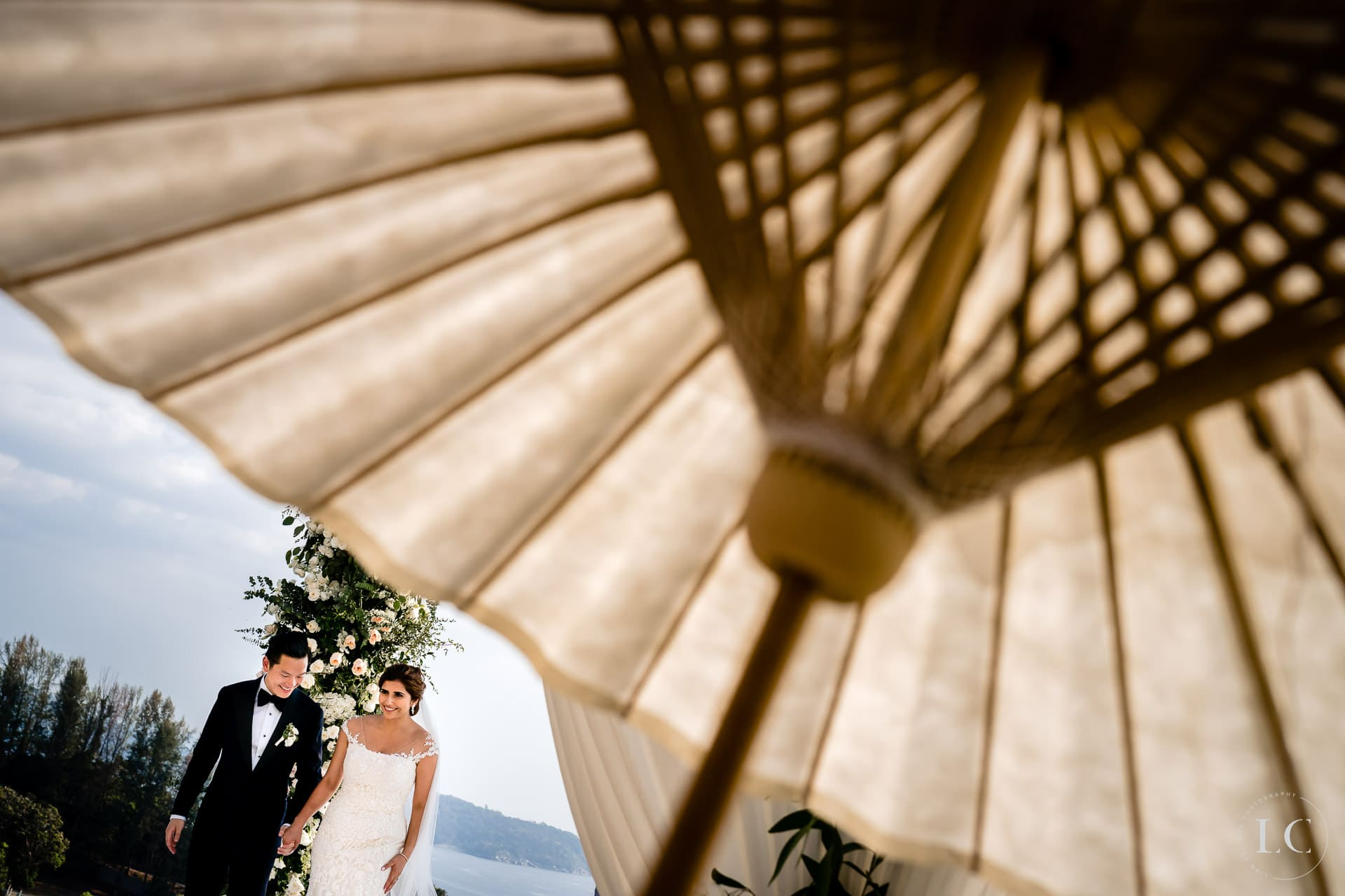 Bride under umbrella