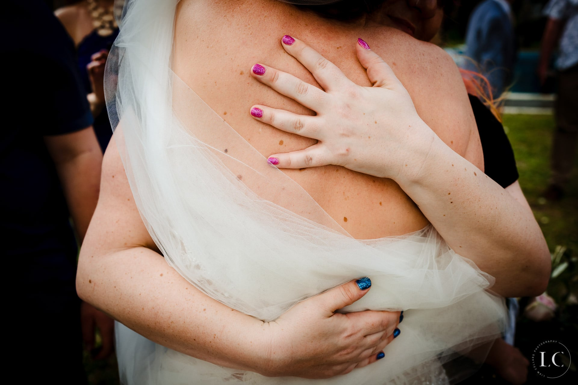 Bride hugging a friend