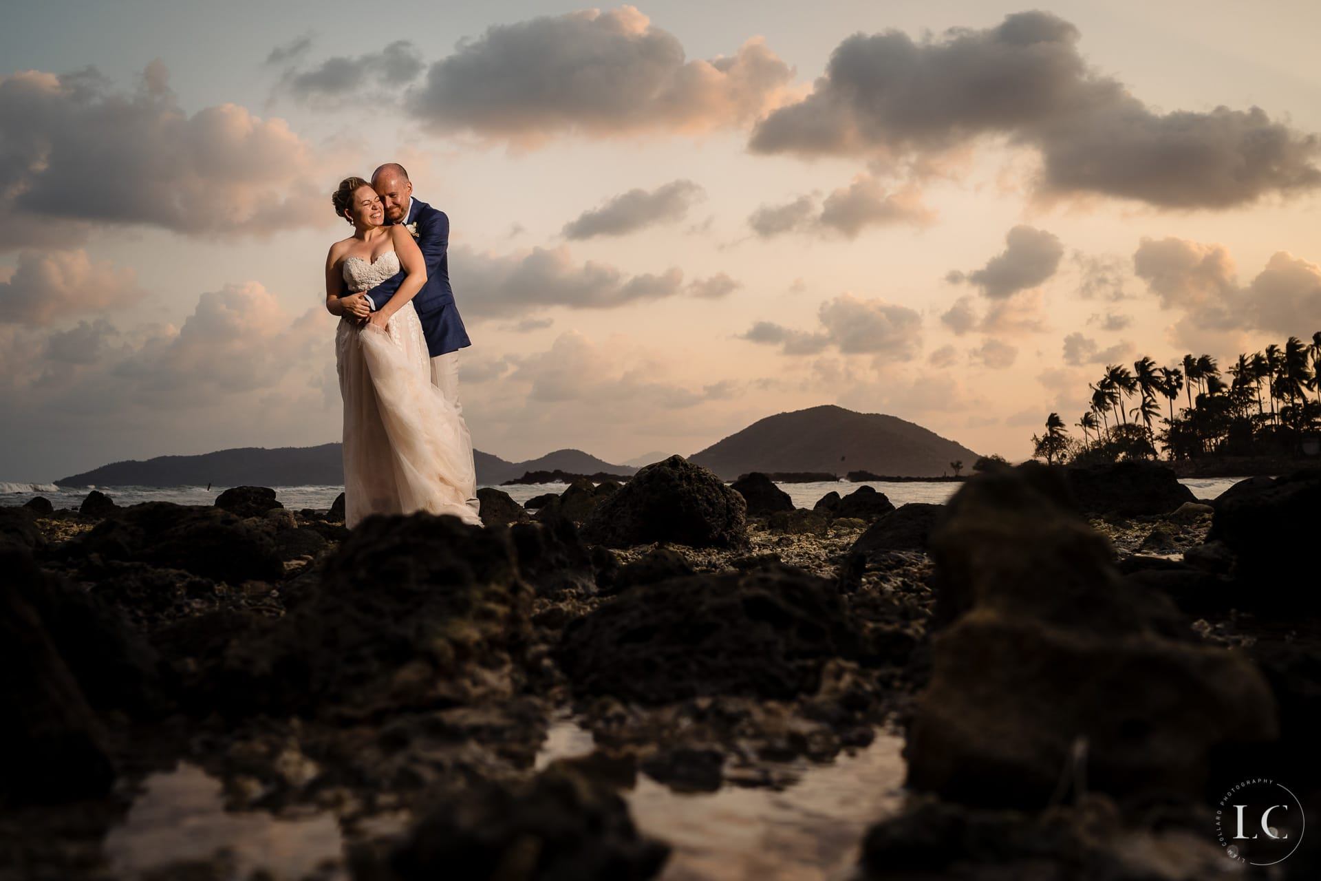 Bride and groom embracing at sunset